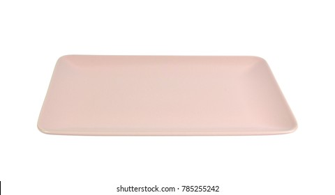 Square pink porcelain plate isolated on white background