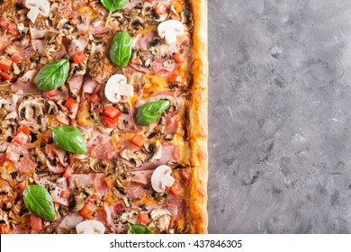square pizza with basil tomatoes and mushrooms