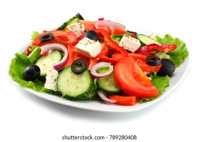 Square plate of greek salad isolated on white. fresh vegetable salad
