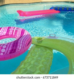 Square pool floats in pool