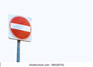 A square red sign with a white bar indicating 'NO ENTRY' on a grey metal post against white background.