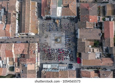 Square with restaurants in the center of the fortress town Aigues-Mortes in France. Aeria top view.