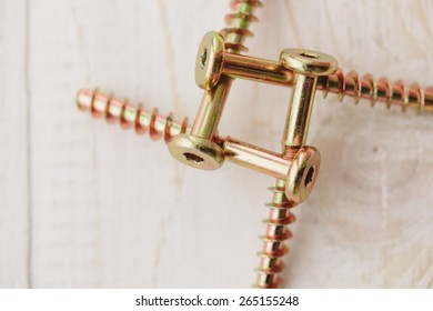 Square of the screws on the wooden background