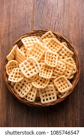 Square shape checkered Fryums Papad is a crunchy Snack Pellets served in a bowl
