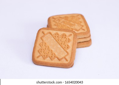 Square shaped sweet shortbread cookies on a white background