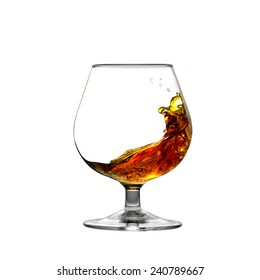 Square shot of cognac moving inside a glass isolated on white