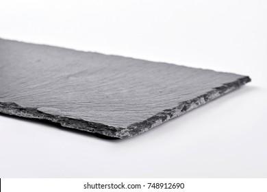 Square slate tray, white background. Dark gray slate plate over white background.