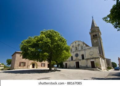 The square and St.Michael`s church in Zminj