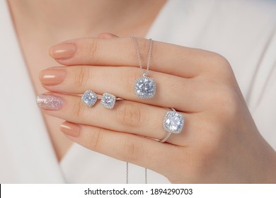 square stone diamond jewelry set in white outfit lady hands