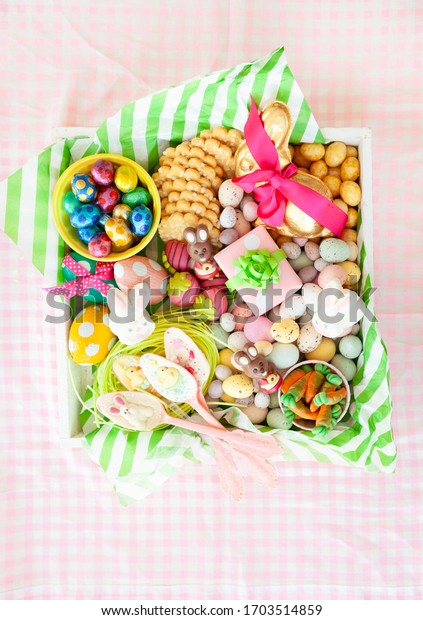 Square tray with cheerful easter treats and chocolates