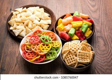 Square , triangle, wheel and pipe shape Fryums Papad or fingers is a crunchy Snack Pellets served in a bowl