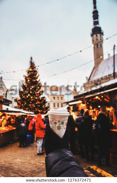 Square view in Tallinn. Glass with the Christmas market on the background.