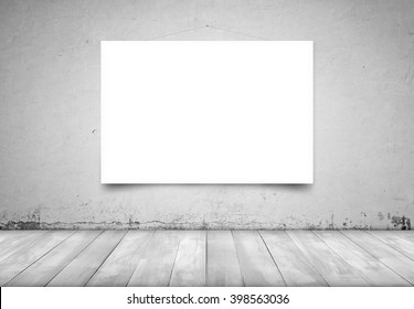 Square white canvas hanging on concrete wall in interior