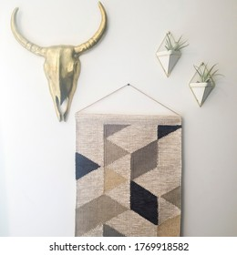 Square Woven tapestry metal bull head and plant hanger decorations against white wall