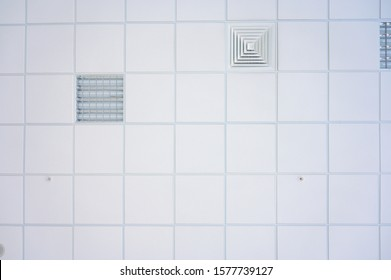 Squared background concept in white. Photo of the ceiling in the building.