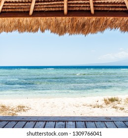 Squared image of a beautiful beach wooden hut with a view on the ocean. Tropical luxurious sea resort