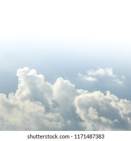 Squared image of beautiful gradient azure sky with soft clouds. White copy space for text on the top.