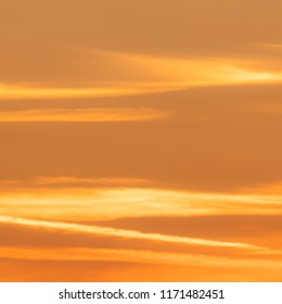 Squared image of beautiful sunset sky with soft clouds. Orange, pastel tone. Concept for tranquillity,calmness, joy, warmth, heat, enthusiasm, creativity, success, encouragement, determination, health