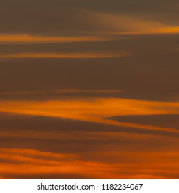 Squared image of beautiful sunset sky with clouds. Red, orange, pastel tone. Concept or background for passion, desire, heat, longing, lust, sexuality, sensitivity, romance, rage, anger, danger