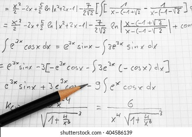 squared paper with maths-formulas and a pencil