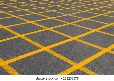 Squares with yellow lines on tarmac, seen in Fuerteventura, Spain