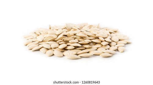 Squash, courgette, zucchini, decorative pumpkin or vegetable marrow dry seeds isolated on white background close up