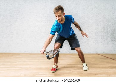 Squash game training, male player with racket