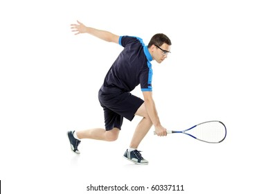A squash player playing against white background