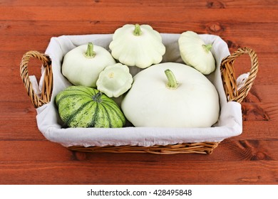 squash in a wicker basket on a wooden background