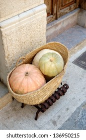 Squashes in a basket outside a cafe in Pollensa, Mallorca, Spain