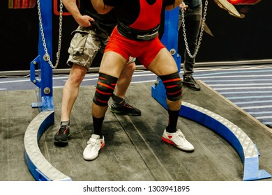 squat in powerlifting athlete powerlifter coach insures in exercise