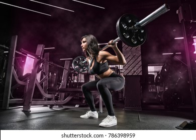 Squats with a barbell in the gym, the development of leg muscles, strengthening of the spine after injuries