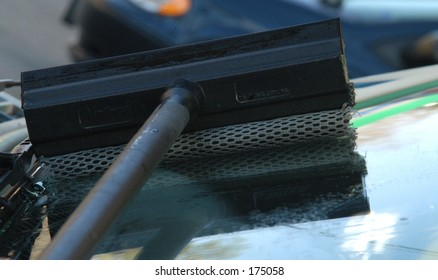 squeegee on car windshield