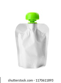 Squeeze pouch with healthy baby food on white background