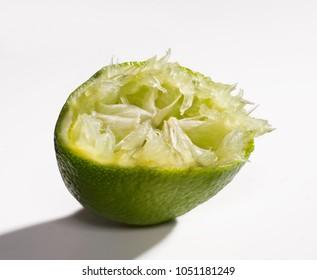 Squeezed lemon isolated on white background.