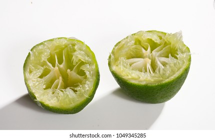 Squeezed lemons on white background,