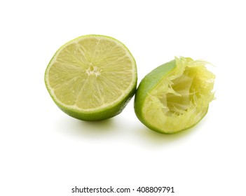 Squeezed limes isolated on white background