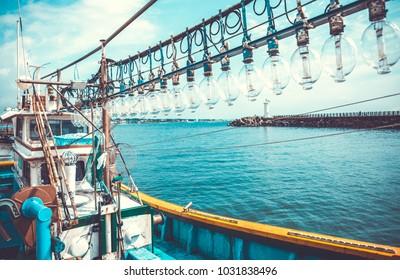 Squid fishing boat entering port - Jeju island, South Korea