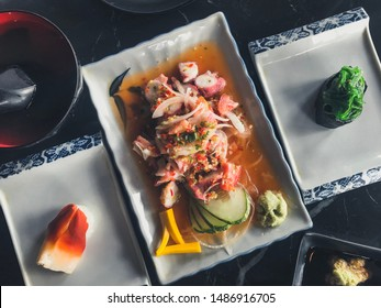 Squid  salad and sushi  on the table
