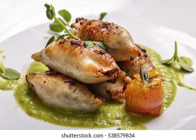 Squid Stuffed with Meat and Vegetables with white background