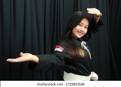 Sragen, Central Java, Indonesia – March 25 2020 : young woman performed Indonesian martial arts