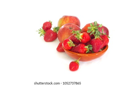 Srawberries and apples on white