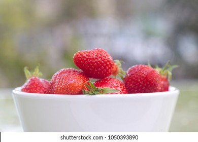 Srawberries in white bowl