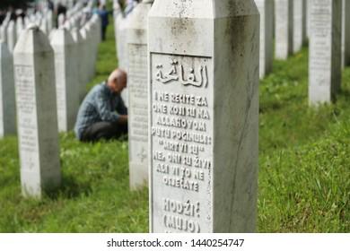 Srebrenica / Bosnia Herzegovina - 11.07.2018: Memorial Day in Srebrenitsa on July 11, people praying for their lost loved ones.