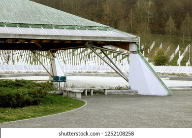 Srebrenica-Potocari/Bosnia and Herzegovina,November 2018:Memorial and cemetery for the victims of the 1995 massacre over muslims.Memorial of Srebrenica massacre with gravestones n the background.