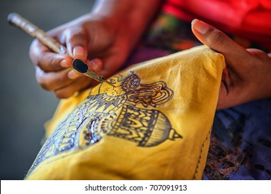 Sri Lanka, Anuradhapura. Artist sketching with an instrument to create a traditional work of art. Spouted tool - canting. Tjanting.