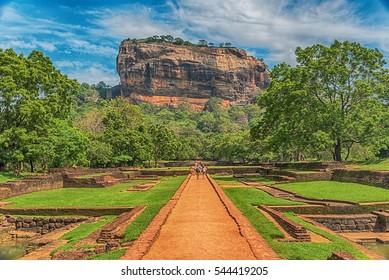 Sri Lanka: beautiful ancient Lion Rockfortress in Sigiriya or Sinhagiri, located near the town of Dambulla, a famous Sri Lankan landmark. The Gardens of Sigiriya in the foreground.
