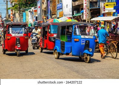 SRI LANKA, COLOMBO - JANUARY 9, 2015: Tuk tuk Sri Lankan traditional taxi in one of the street of Colombo