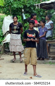 SRI LANKA - DECEMBER 7, 2008:Unknown family out of the village on the island of Ceylon.