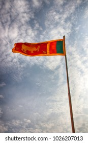 Sri Lanka flag (the Lion flag or Sinha flag) waving in the wind against a blue sky in the Galle Fort, Southern Province